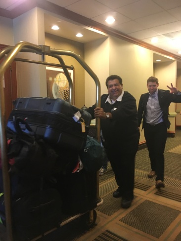 Ernesto helping lug 200+ bags to two buses; Payton also bringing Business class back