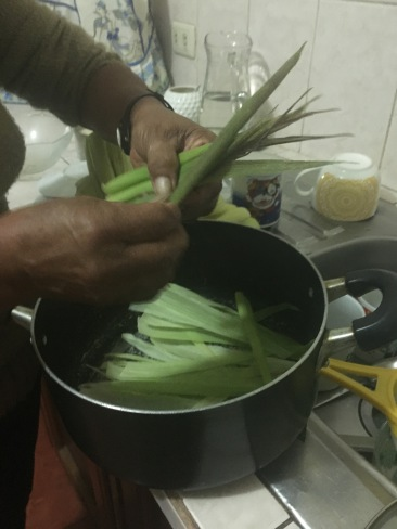 Steaming the wrapped corn meal